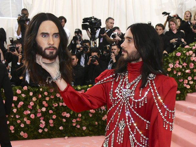 "Jared Leto, holding a model of his own head, attends The Metropolitan Museum of Art's Costume Institute benefit gala celebrating the opening of the ""Camp: Notes on Fashion"" exhibition on Monday, May 6, 2019, in New York. (Photo by Charles Sykes/Invision/AP Photo)"