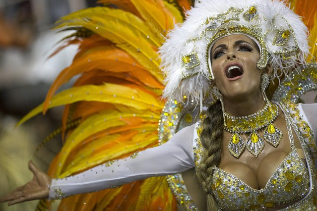 A performer from the Vila Isabel samba school parades during carnival celebrations at the Sambadrome in Rio de Janeiro, Brazil, Tuesday, March 4, 2014. (Photo by Felipe Dana/AP Photo)