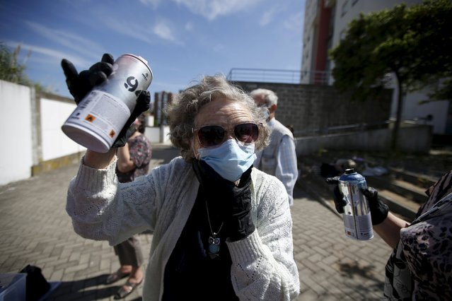 Ivone, 86, shows a spraycan during a graffiti class offered by the LATA 65 organization in Lisbon, Portugal May 14, 2015. (Photo by Rafael Marchante/Reuters)