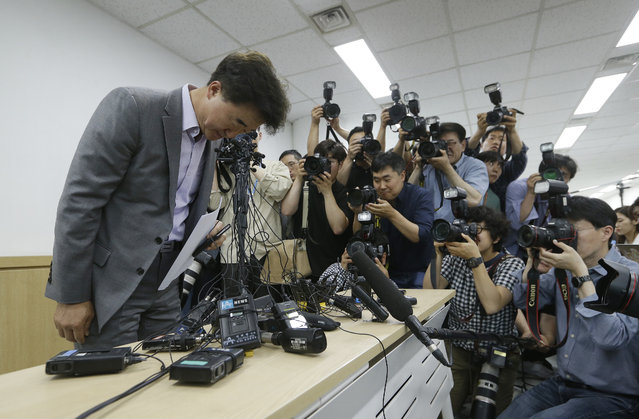 The Very Good Tour agency senior official Lee Sang-moo, left, bows to make an apology during a press conference at its headquarters in Seoul, South Korea, Thursday, May 30, 2019. A sightseeing boat carrying 33 South Korean passengers and two crew members collided with another vessel and sank in the Danube River in downtown Budapest. (Photo by Ahn Young-joon/AP Photo)