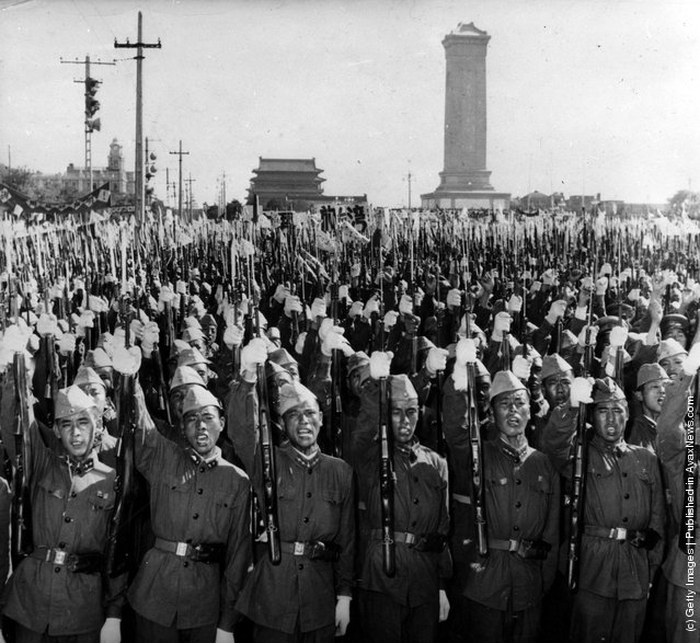 1958: Members of the Chinese People's Liberation Army shouting slogans on the streets of Peking (Beijing) in support of Premier Chou En-lai's statement on the situation in the Formosa Straits