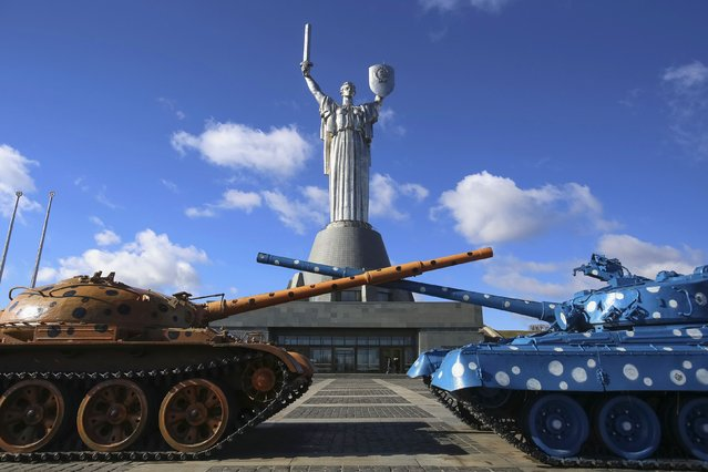 "The 100-metre (300-foot), sword-wielding statue of ""The Motherland"" is seen in the National Museum of the History of the Great Patriotic War in Kiev March 17, 2014. On a blustery day on the banks of the Dnieper, the statue of ""The Motherland"", a Soviet hammer and sickle on her shield, towered overhead, a reminder of the common cause Ukrainians and Russians died for side by side in their millions in World War Two and which Russian President Vladimir Putin thinks Ukraine has betrayed by turning to ""fascism"" and the West. (Photo by Konstantin Grishin/Reuters)"