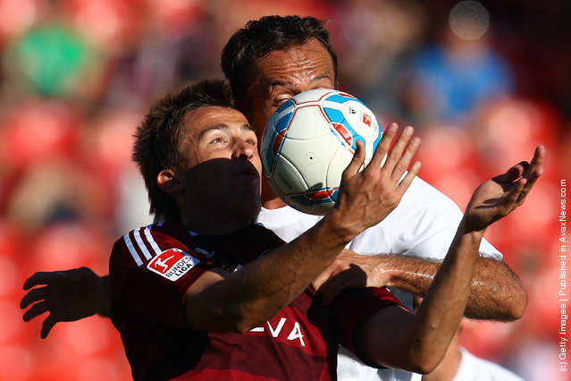 Tomas Pekhart (L) of Nuernberg battles for the ball with Nikolce Noveski of Mainz