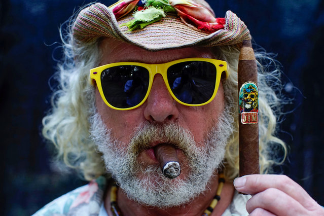 Jim Robinson of the U.S. poses for a photo holding a cigar of his own brand in Havana, Cuba, March 1, 2017. Picture taken March 1, 2017. (Photo by Alexandre Meneghini/Reuters)