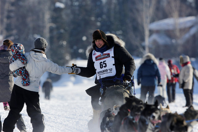 John Baker competes in the official restart of the Iditarod, a nearly 1,000 mile (1,610 km) sled dog race across the Alaskan wilderness, in Fairbanks, Alaska, U.S. March 6, 2017. (Photo by Nathaniel Wilder/Reuters)