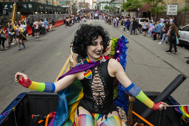 """Playing Frankenfurter from """"The Rocky Horror Picture Show"""", Lauren Montgomery, 34, rides in a truck making its way through the procession during the Motor City Pride Parade on June 9, 2019 in Detroit, Michigan. (Photo by Brittany Greeson/Getty Images)"""