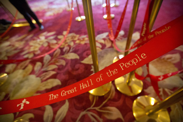 In this Wednesday, March 8, 2017 photo, a man stands near rope lines used to line up journalists during a plenary session of China's National People's Congress (NPC) at the Great Hall of the People in Beijing. (Photo by Mark Schiefelbein/AP Photo)