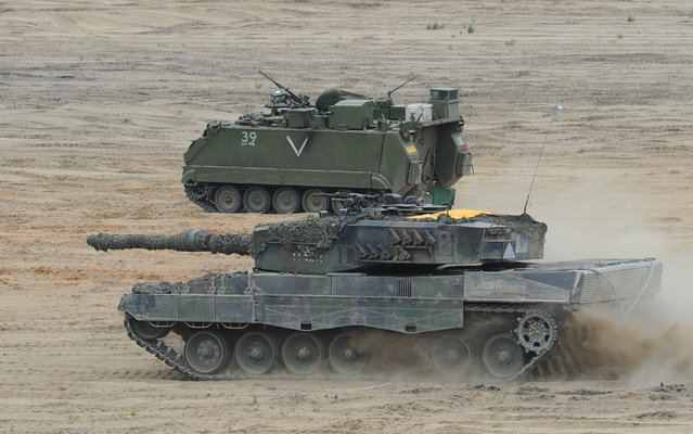 A Polish Army tank takes part in the NATO Noble Jump exercise on a training range near Swietoszow Zagan, Poland, Thursday, June 18, 2015. (AP Photo/Alik Keplicz)
