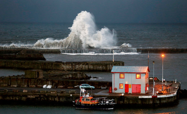 High waves hit the harbour wall at Seaham, County Durham, UK on April 26, 2016. (Photo by  Owen Humphreys/PA Wire)