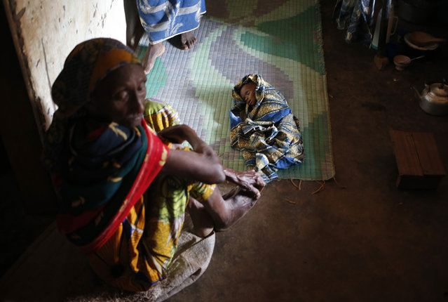 A sick internally displaced Muslim child lies in a house in the town of Boda April 15, 2014. (Photo by Goran Tomasevic/Reuters)