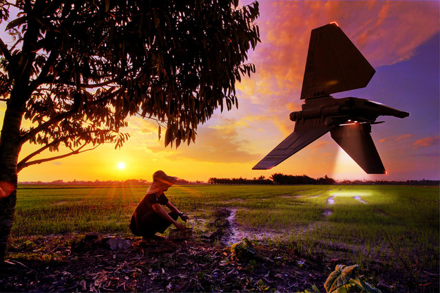 An imperial shuttle spacecraft Star Wars spacecraft flies over rice fields in Malaysia. (Photo by Zahir Batin/Mercury Press)