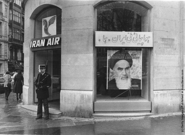 1979: A poster of the Iranian Muslim leader Ayatollah Ruhollah Khomeini (1900 - 1989) in the window of Iran Air in Paris, France