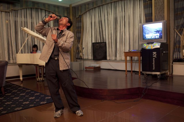 A North Korean man sings karaoke while his daughter plays the piano at a hotel bar in Mount Kumgang, North Korea, Friday October 7, 2011. (Photo by David Guttenfelder/AP Photo)