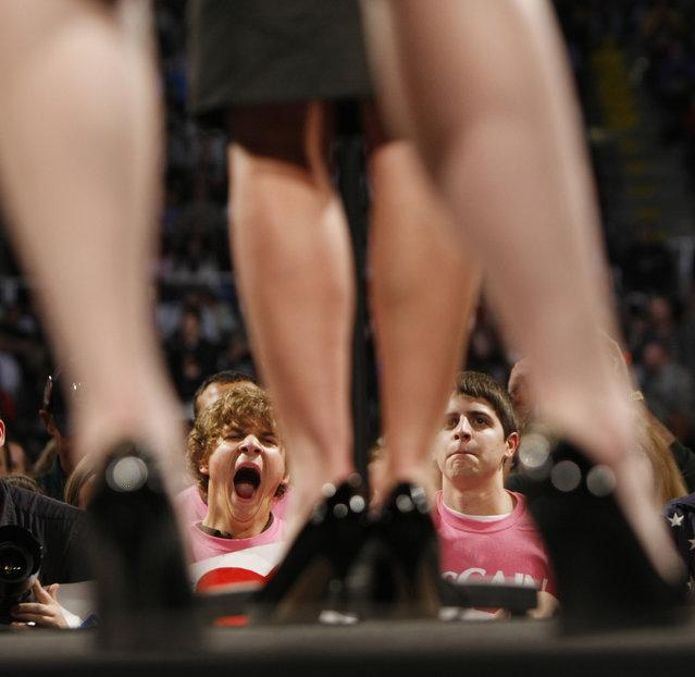 Supporters listen to Republican vice presidential running mate, Alaska Gov. Sarah Palin, legs visible, during a rally with Republican presidential candidate, Sen. John McCain, R-Ariz., not visible, in Bethlehem, Pa., Wednesday, October 8, 2008. (Photo by Gerald Herbert/AP Photo)