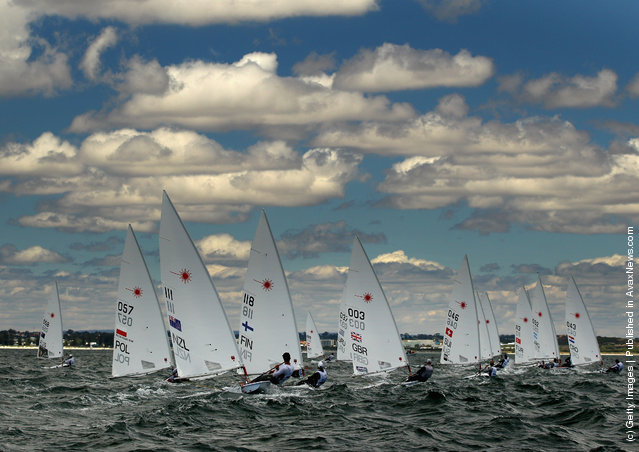 The Laser Men's One Person Dinghy fleet round a mark on the Parmeila Course