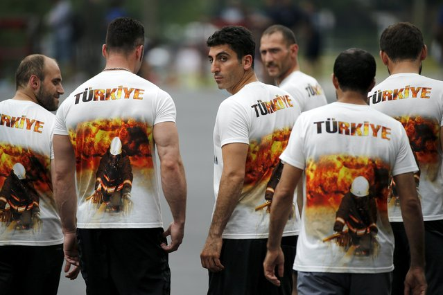 Members of the Turkish team from Istanbul walk to the start line for the hose cart competition of the Firefighter Muster event at the World Fire and Police Games in Fairfax, Virginia July 4, 2015. (Photo by Jonathan Ernst/Reuters)