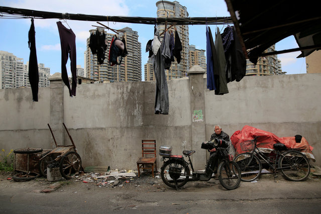A man sits in an alley in Guangfuli neighbourhood in Shanghai, China, March 24, 2016. (Photo by Aly Song/Reuters)