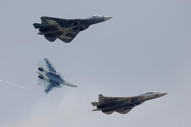 Sukhoi Su-57 fighter jets perform during a demonstration flight at the MAKS 2019 air show in Zhukovsky, outside Moscow, Russia, August 27, 2019. (Photo by Maxim Shemetov/Reuters)