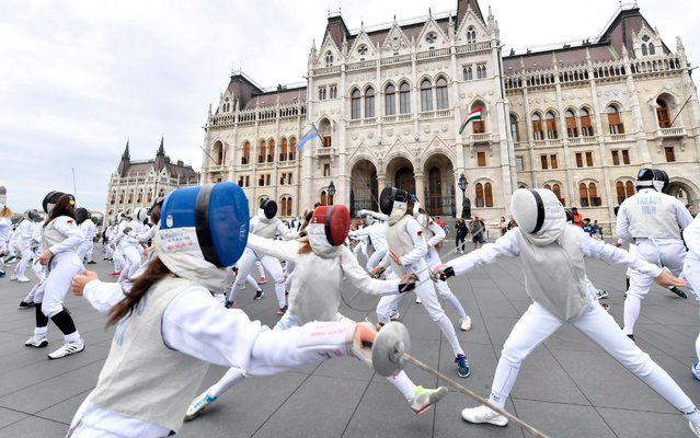 Fencers take part in a flashmob organised by the Hungarian Fencing Federation to mark World Fencing Day in Heroes' Square in Budapest, Hungary, Saturday, September 7, 2019. (Photo by Tibor Illyes/MTI via AP Photo)