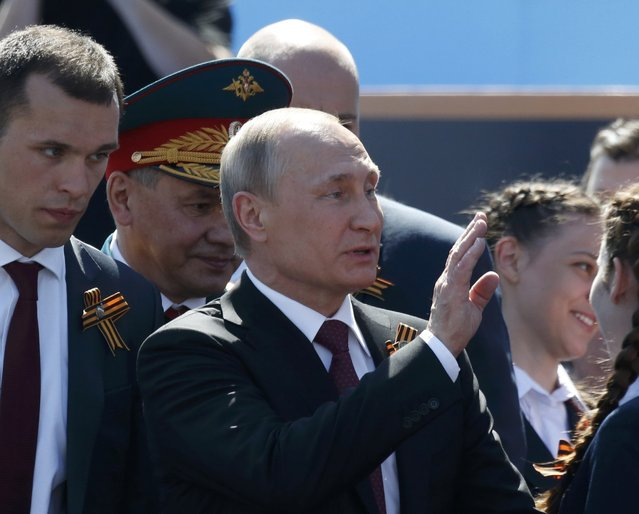 Russian President Vladimir Putin and Defence Minister Sergei Shoigu attend the Victory Day parade, marking the 71st anniversary of the victory over Nazi Germany in World War Two, at Red Square in Moscow, Russia, May 9, 2016. (Photo by Grigory Dukor/Reuters)
