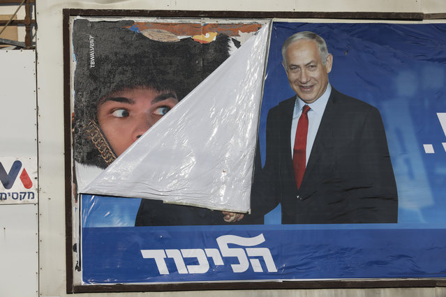 A campaign poster for Israeli Prime Minister Benjamin Netanyahu is seen in Bnei Brak, Israel, Tuesday, September 17, 2019. Israelis began voting Tuesday in an unprecedented repeat election that will decide whether longtime Prime Minister Benjamin Netanyahu stays in power despite a looming indictment on corruption charges. (Photo by Oded Balilty/AP Photo)