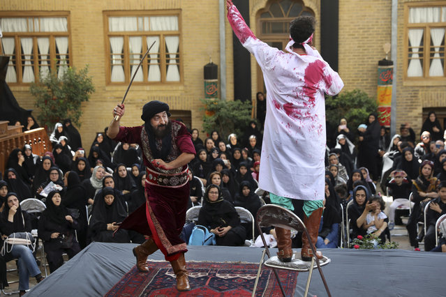 Actors perform Tazieh, a traditional play re-enacting the death of Hussein, the grandson of Prophet Muhammad and 72 of his companions, a day ahead of Ashoura, in downtown Tehran, Iran, Monday, September 9, 2019. Ashoura falls on the 10th day of Muharram, the first month of the Islamic calendar, when Shiites mark the death of Hussein, at the Battle of Karbala in present-day Iraq in the 7th century. (Photo by Vahid Salemi/AP Photo)