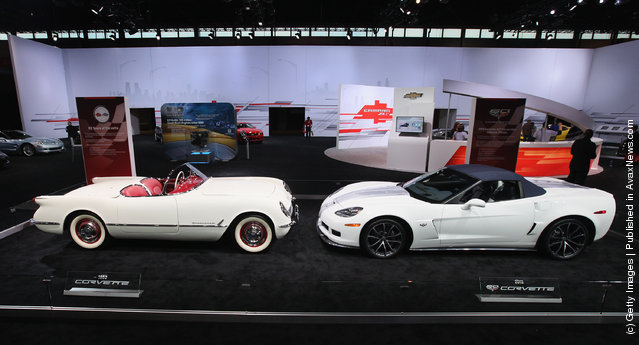 A 1953 Chevrolet Corvette sit nose to nose with a 60th anniversary 2013 Corvette 427 Convertible Collectors Edition during the media preview of the Chicago Auto Show