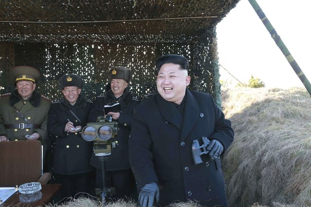 North Korean leader Kim Jong Un (R) laughs as he watches a drill by the Korean People's Army (KPA) for hitting enemy naval target at undisclosed location in this undated photo released by North Korea's Korean Central News Agency (KCNA) in Pyongyang January 31, 2015. (Photo by Reuters/KCNA)