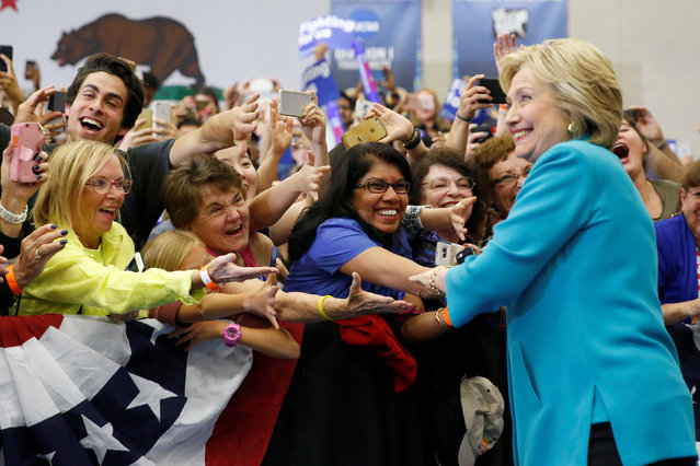 Supporters greet U.S. Democratic presidential candidate Hillary Clinton as she arrives to speak at the University of California Riverside in Riverside, California, U.S. May 24, 2016. (Photo by Lucy Nicholson/Reuters)
