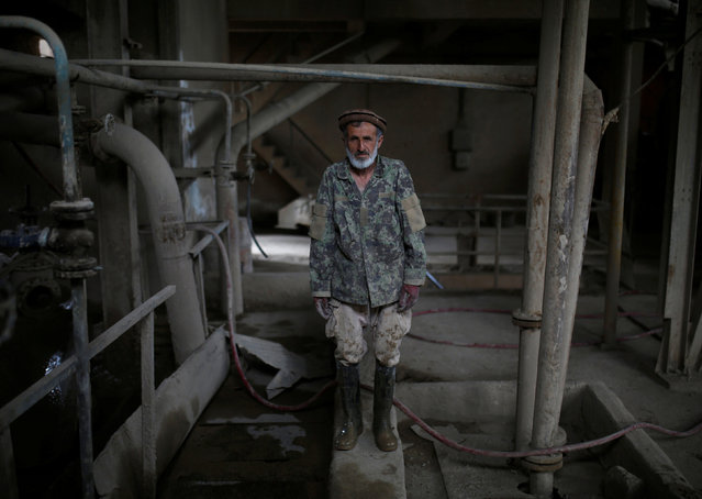 Dadullah, a worker at the Jabal Saraj cement factory, poses for a photograph in Jabal Saraj, north of Kabul, Afghanistan April 19, 2016. (Photo by Ahmad Masood/Reuters)
