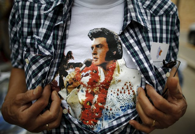 An Elvis Presley fan shows his T-shirt at the four-day Collingwood Elvis Festival in Collingwood, Ontario July 25, 2015. (Photo by Chris Helgren/Reuters)