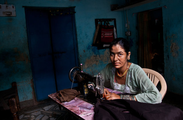 """""""Sewing"""". This photo was taken in the village of Oceana city of Jodhpur Rajasthan region. Photo location: Central India. (Photo and caption by Osama Alsulami/National Geographic Photo Contest)"""
