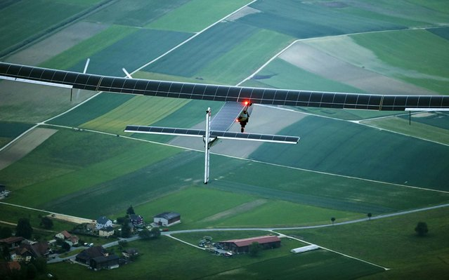 German test pilot Markus Scherdel steers the solar-powered Solar Impulse 2 aircraft for its maiden flight at its base in Payerne, Switzerland, on June 2, 2014. (Photo by Denis Balibouse/Pool)