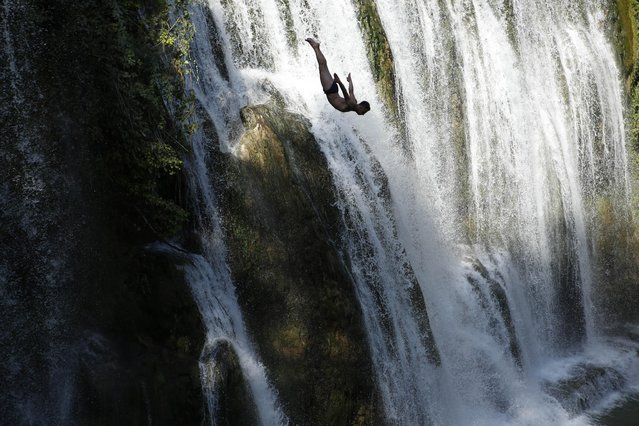 A competitor dives during the international waterfall jumping competition in the old town of Jajce, 250 kms west of Sarajevo, Bosnia, on Saturday, August 1, 2015. A total of 25 competitors took part in the jump at 20 meters high. (Photo by Amel Emric/AP Photo)