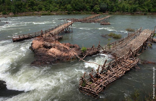 People of the Mekong have invented all manner of ingenious ways of catching fish, many of them adapted to a specific site, flow and time of year. These lee traps at the Khone Falls in southern Laos, captured on June 2, 2010, are an excellent example: fishermen construct the traps in the dry season when water levels are low to catch fish at the onset of the rainy season. As the rising water levels cue the fish to begin their migration, the traps are inundated and literally strain the migrating fish out of the water column