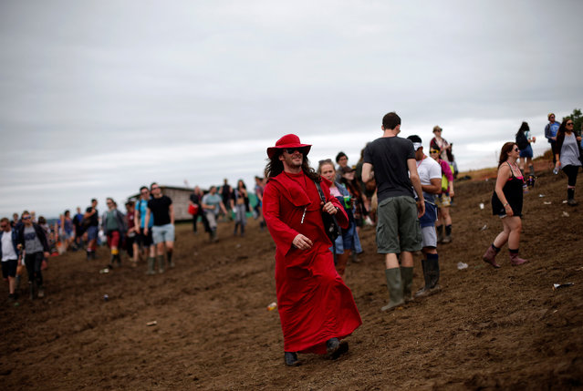 A reveller takes part in the Vloody Cloody Heroes Parade during the Glastonbury Festival at Worthy Farm in Somerset, Britain, June 23, 2016. (Photo by Stoyan Nenov/Reuters)