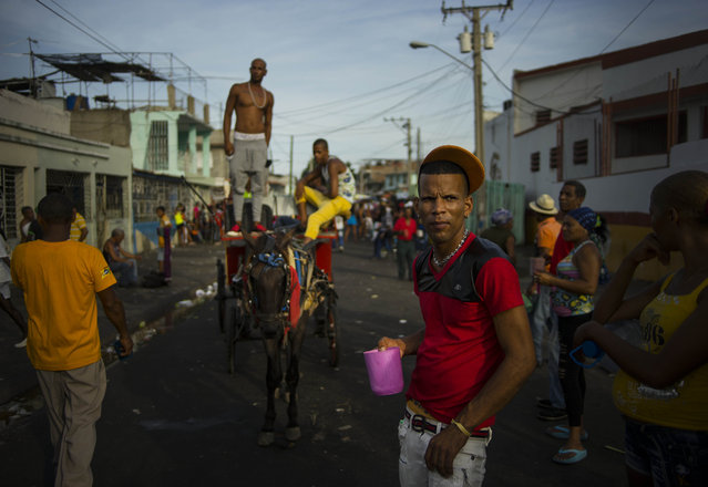 In this July 27, 2015 photo, people attend a concert during carnival celebrations in Santiago, Cuba. Cuban officials say Santiago has roughly 1,500 of Cuba's 60,000 hotel rooms, far fewer than it needs. (Photo by Ramon Espinosa/AP Photo)