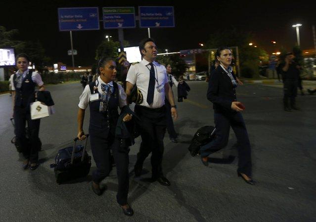 Airline crew members leave Turkey's largest airport, Istanbul Ataturk, Turkey, following a blast June 28, 2016. (Photo by Murad Sezer/Reuters)