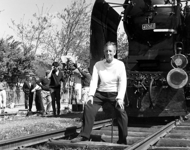 """In this June 23, 1963  photo, British writer Ian Fleming, author of the James Bond spy thrillers, sits in front of a Turkish train, as a gag, during a visit to the set of the film """"From Russia With Love"""" in Istanbul, Turkey. Fleming, a former World War II intelligence officer, created 007 as a sort of fantasy alter-ego. (Photo by Ahmet Baran/AP Photo)"""
