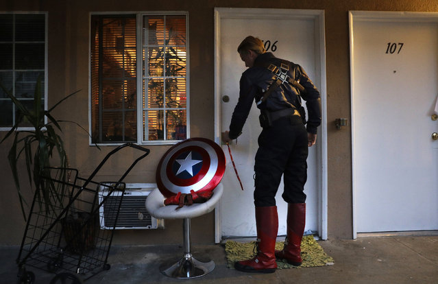 "In this Monday, May 8, 2017 photo, Captain America impersonator Henry Hodge, a cinematographer from England who lives a stone's throw away from Hollywood's Dolby Theatre, opens his apartment door in Los Angeles. ""The boulevard is the only thing that gives me the freedom to do what I really want to do"", said Hodge. ""I never have to miss a film meeting. I'm always available to shoot"". (Photo by Jae C. Hong/AP Photo)"