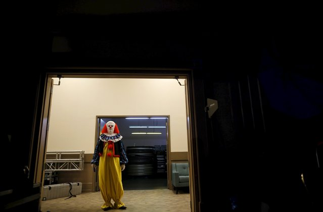 A contestant looks on from the hallway after competing in the costume contest at Wizard World Comic Con in Chicago, Illinois, United States, August 22, 2015. (Photo by Jim Young/Reuters)