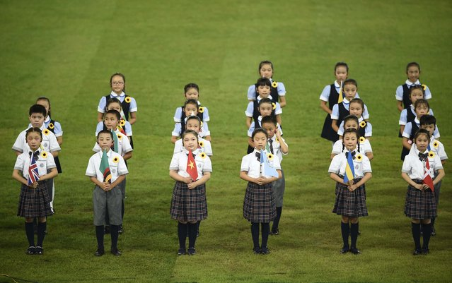 Children take part in the closing ceremony of the 15th IAAF Championships at the National Stadium in Beijing, China August 30, 2015. (Photo by Dylan Martinez/Reuters)