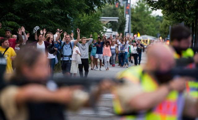 Police evacuates people from the shopping mall in Munich on July 22, 2016 following a shootings earlier. At least one person has been killed and 10 wounded in a shooting at a shopping centre in Munich on Friday, German police said. (Photo by AFP Photo/Stringer)