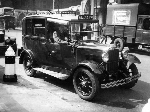 A Morris Commercial taxi-cab and its driver. 11th April 1935.