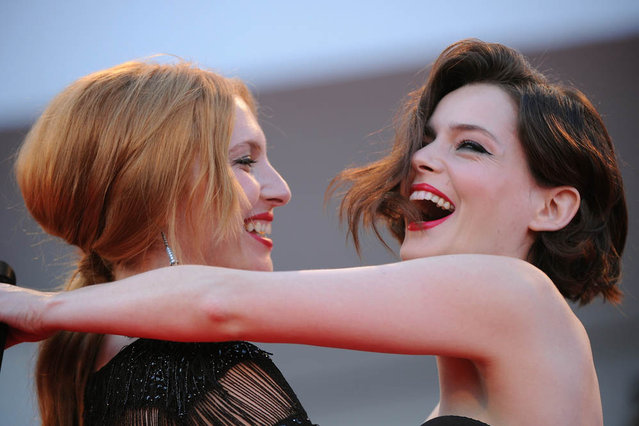 French actress Roxane Mesquida (R) and Josephine De La Baume reacts after exchanging a kiss on the red carpet prior the screening of The company you keep during the 69th Venice Film Festival on September 6, 2012 at Venice Lido. The company you keep is presented out of competition.  AFP PHOTO / TIZIANA FABI