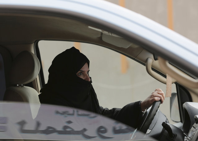 In this Saturday, March 29, 2014 file photo, Aziza Yousef drives a car on a highway in Riyadh, Saudi Arabia, as part of a campaign to defy Saudi Arabia's ban on women driving.  Saudi Arabia says it will allow women to drive for the first time in the ultra-conservative kingdom. The kingdom, which announced the change on Tuesday, September 26, 2017, was the only the country in the world to bar women from driving and for years had garnered negative publicity internationally for detaining women who defied the ban. (Photo by Hasan Jamali/AP Photo)