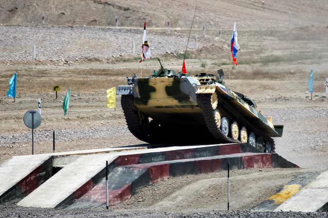 Russia's army crew rides on a Light Multi-Purpose Armoured Towing Vehicle during mortar units competition at the International Army Games 2016 at Gvardeisky Range, Kazakhstan, August 2, 2016. (Photo by Shamil Zhumatov/Reuters)