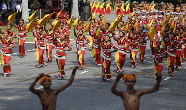 Sri Lankan traditional dancers perform during an event to mark the anniversary of country's independence from British colonial rule in Colombo, Sri Lanka, Tuesday, February 4, 2020. (Photo by Eranga Jayawardena/AP Photo)