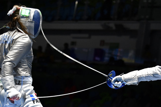 France's Charlotte Lembach (L) competes against Italy's Irene Vecchi during their womens individual sabre qualifying bout as part of the fencing event of the Rio 2016 Olympic Games, on August 8, 2016, at the Carioca Arena 3, in Rio de Janeiro. (Photo by Fabrice Coffrini/AFP Photo)