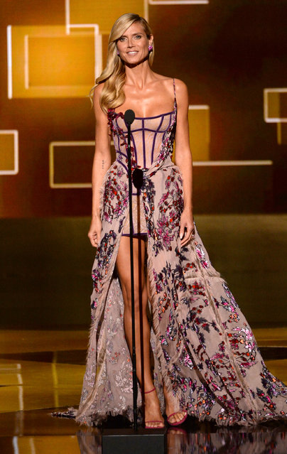 Heidi Klum speaks on stage at the Television Academy's Creative Arts Emmy Awards at Microsoft Theater on Saturday, September 12, 2015, in Los Angeles. (Photo by Phil McCarten/Invision for the Television Academy/AP Images)